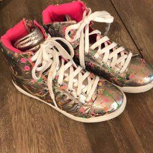 Stevie's high top graffiti splatter sneakers.